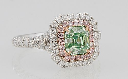 Lady's 18K White Gold Dinner Ring, with an 1.25 carat emerald cut green diamond, within a rose gold border of pink round diamonds an...