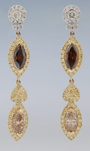 Pair of 14K Yellow Gold Dangle Earrings, with a white diamond stud, suspending an oval link with a fancy brown marquise diamond atop...