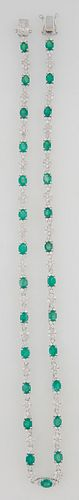 18K White Gold Link Necklace, with 27 oval links mounted with oval emeralds, flanked by diamond mounted triangular lugs, joined by 2...