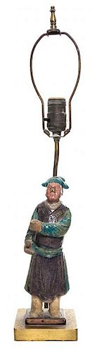 * A Sancai Glazed Pottery Figure of a Male Height of figure 10 1/2 inches.