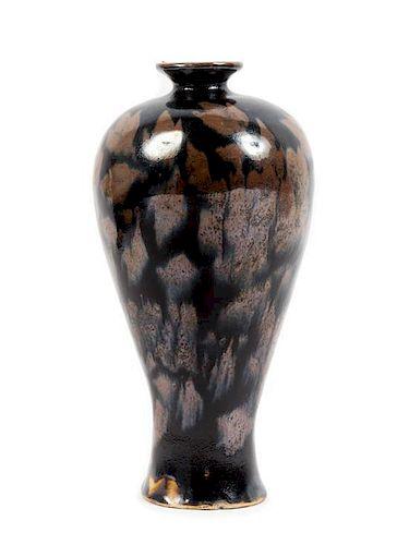 * A Jizhou Style Black Glazed Russet Splashed Stoneware Vase Height 9 inches.