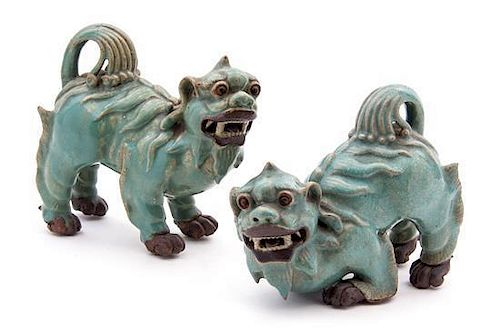 A Pair of Chinese Blue Glazed Stoneware Temple Lions Width of widest 6 3/4 inches.