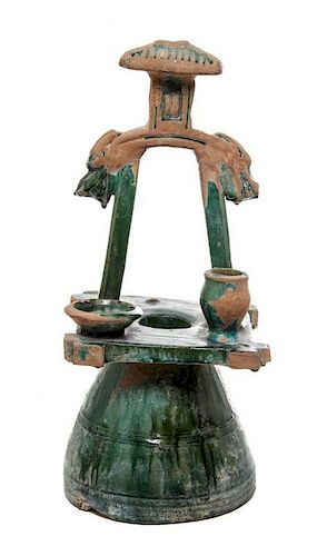 * A Green Glazed Pottery Roof Ornament Height 16 inches.