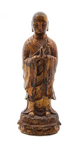 * A Gilt Lacquered Bronze Figure of a Praying Monk Height 7 3/4 inches.