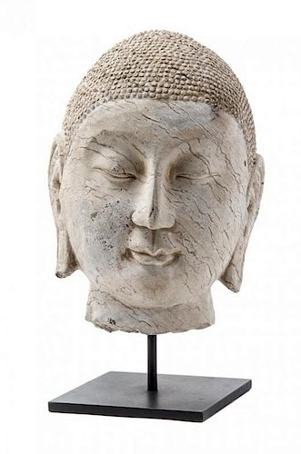 A Carved Stone Head of Buddha Height 12 inches.