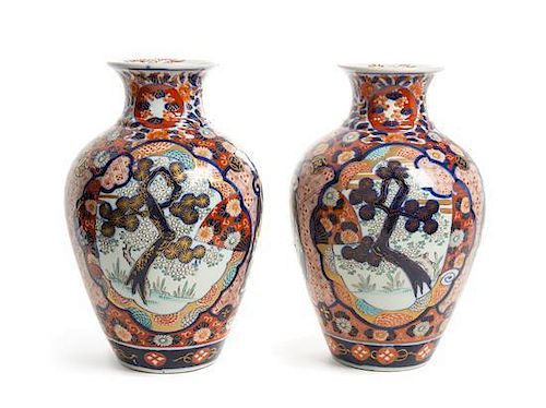A Pair of Japanese Imari Porcelain Vases Height 12 1/4 inches.