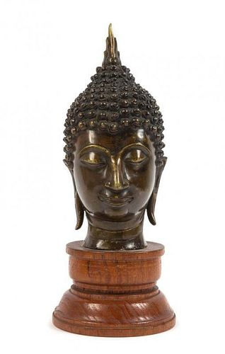 * A Southeast Asian Bronze Head of Buddha Height overall 9 1/4 inches.