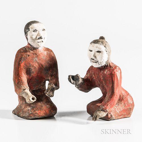 Two Kneeling Figures
