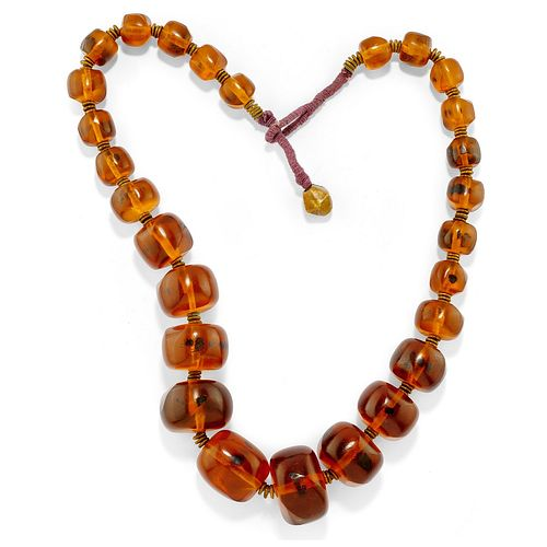 A metal and amber necklace