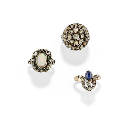 Three silver, low-carat gold, diamond, opal and sapphire rings, defects