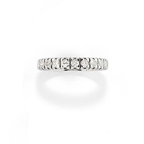 A 18K white gold and diamond eternity ring