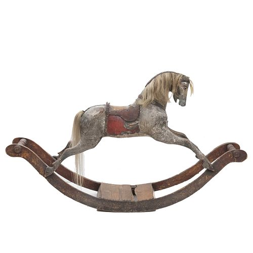 Rocking horse. Late 19th century. Wood carving with polychromy and natural horsehair. Decorated with leather and metal applications.