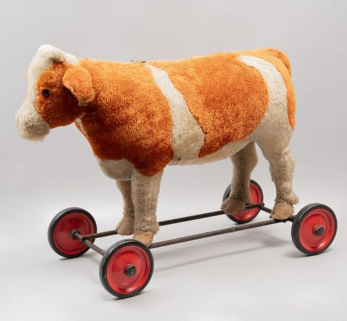 Rideable Cow Toy. Germany. 20th century. Steiff. Plush toy. Wheel supports.
