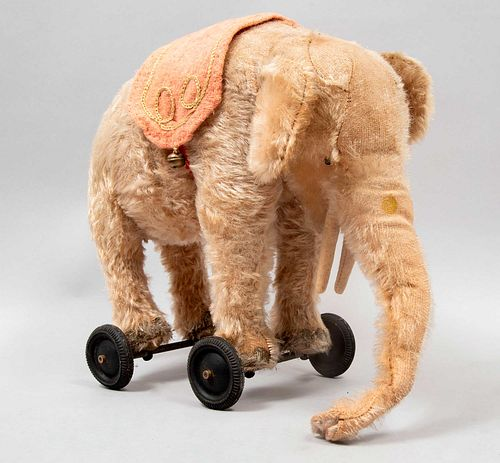 Toy Elephant. Germany. 20th century. Steiff. Plush and plastic toy. Wheel supports.