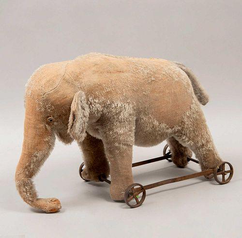 Toy Elephant. Germany. 20th century. Steiff. Plush toy. Metal wheel supports.