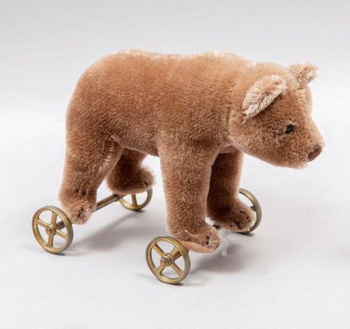 Teddy Bear. Germany. 20th century. Steiff. Plush toy. Metal wheels support. With button.
