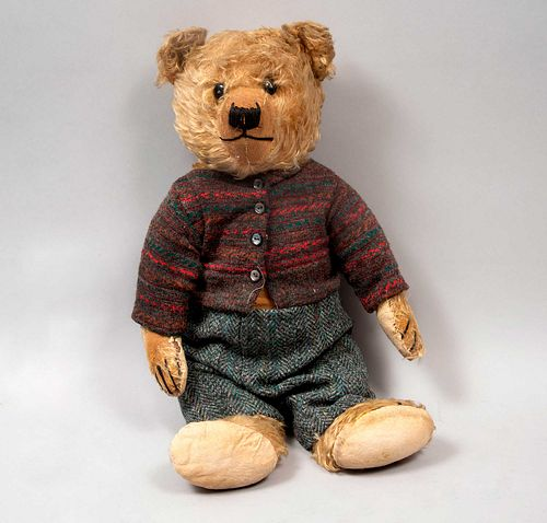Teddy Bear. Germany. 20th century. Steiff. Plush toy. Dressed in pants and sweater.