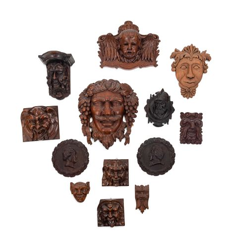 Thirteen Continental Carved Wood Masks