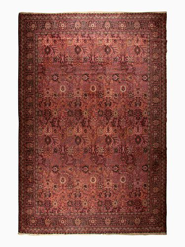 A Machine-Woven Persian Style Wool Rug