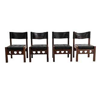 Lote de 4 sillas. México. SXX. Don S. Shoemaker. En talla de madera. Con respaldos y asientos capitonados de piel color negro.
