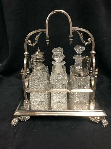 Victorian Cruet Set with Six glass bottles and silver plated frame