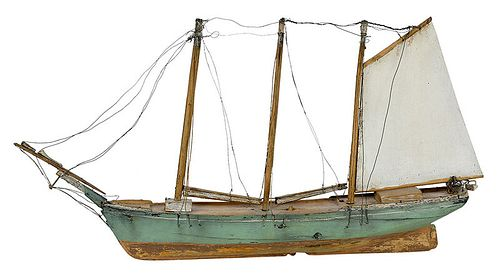 A Carved and Painted Wooden Ship Model