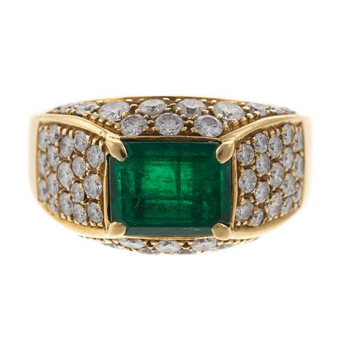 An Emerald & Pave Set Diamond Ring in 18K