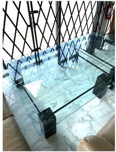 Roche Bobois Marble And Glass Coffee Table Roche Bobois Marble And Glass Coffee Table. 16 Inches high x 47 inches x 47 inches.