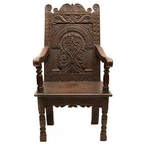 Antique Elizabethan Century carved English arm chair