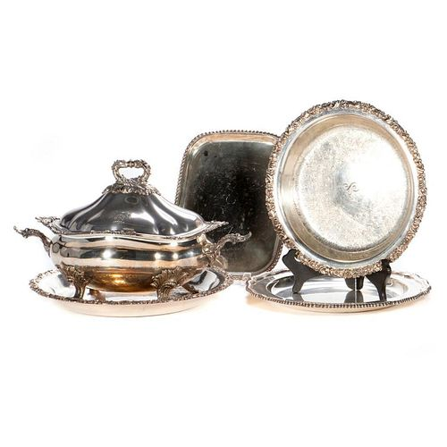 A grouping of silver plated serving pieces