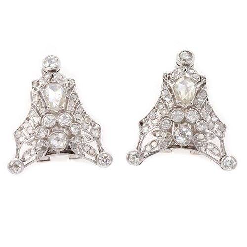 Vintage pair of diamond and platinum clip brooches