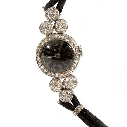 Gubelin diamond, platinum and cord ladies wristwatch
