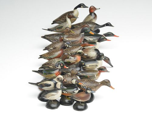 Important and one of the very few known to exist full sets of Elmer Crowell miniature ducks, circa 1930.