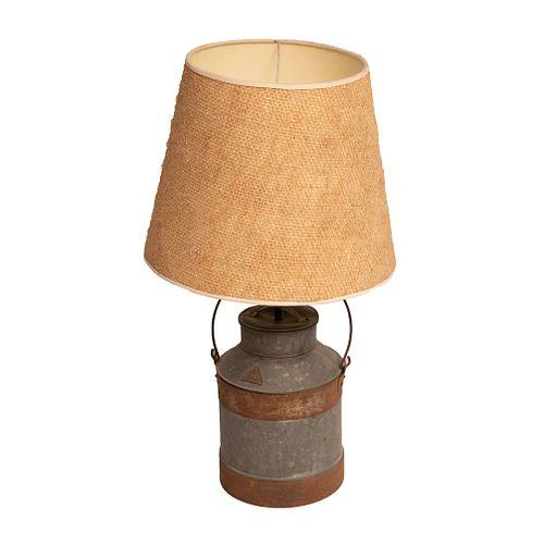 Table lamp. Mexico. ca. 1960. Rustic design. Milk jug, die-cut foil and gunned jute screen.