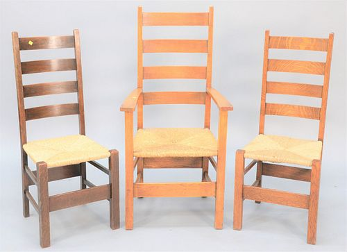 Set of twelve mission oak dining chairs with woven seats.