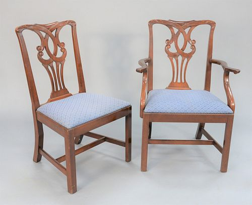 Set of twelve Chippendale-style mahogany dining chairs, two arm and ten side, all with slip upholstered seats.