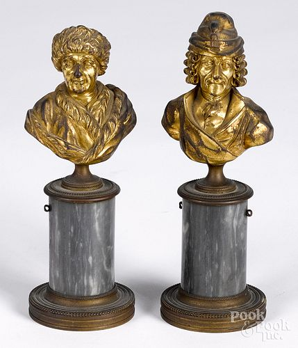 Two gilt bronze busts of Voltaire and Franklin