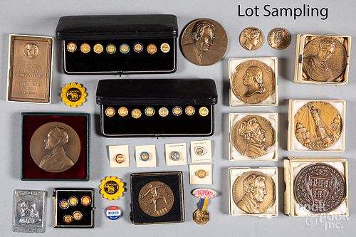 Collection of bronze medallions and pins