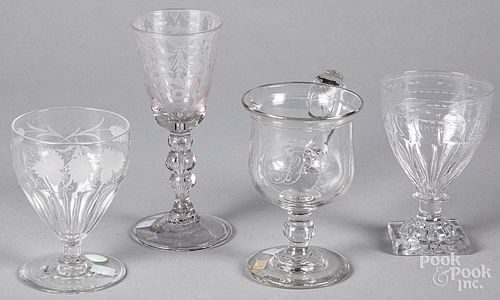 Four pieces of etched colorless glass