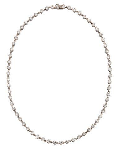 A DIAMOND NECKLACE BY CARTIER, the uniform round brilliant cut diamonds, to