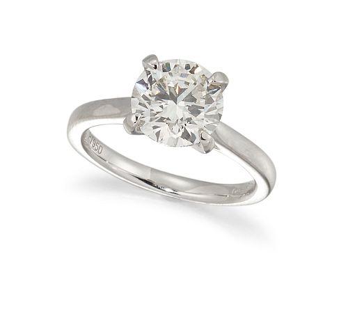 A PLATINUM DIAMOND SOLITAIRE RING, the round brilliant cut diamond, estimat