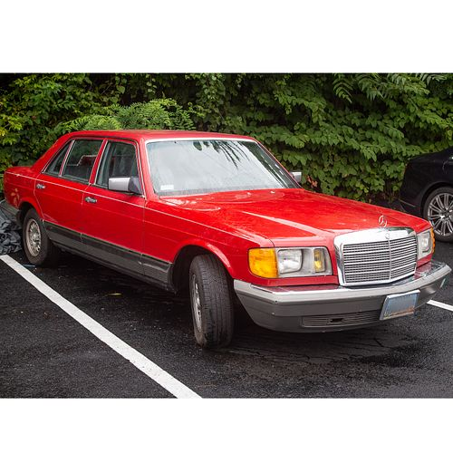 A 1983 Mercedes-Benz Red 380 SEL