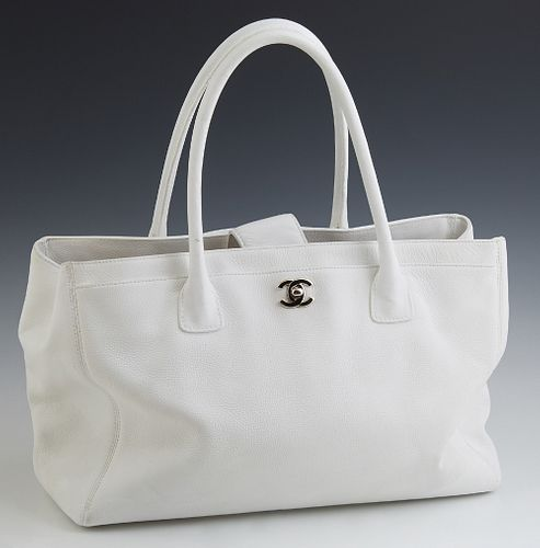 """Chanel White Leather Cerf Tote, c. 1990, the front pocket with silver tone """"CC"""" logo turn-lock closure opening to a woven interior,..."""