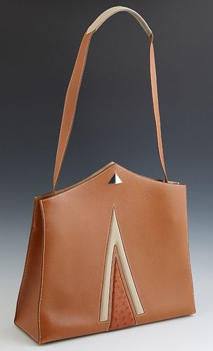 Hermes Victoria Brown Clemence Leather Cabas Shopper, with a silver tone snap button closure opening to a beige lined interior with...