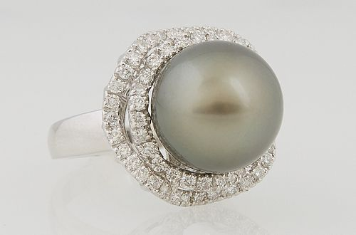 Lady's 14k White Gold Dinner Ring with a 13.88 mm Round Dark Gray Tahitian Natural Pearl, atop an undulating border of small round d...
