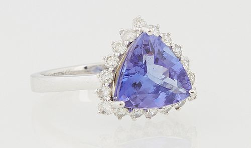 Lady's 14K White Gold Dinner Ring, with a trillion cut 2.78 carat tanzanite a top a conforming border of small round diamonds, total...