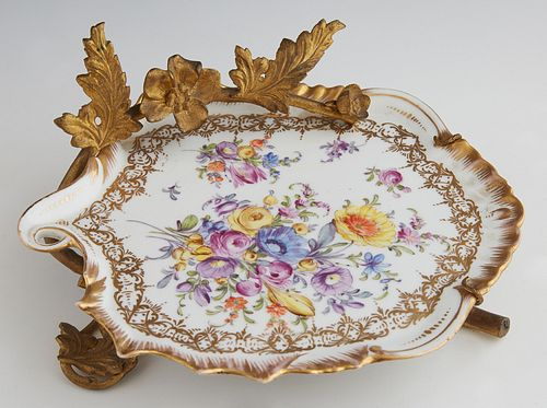 German Polychromed Porcelain Gilt Bronze Mounted Calling Card Plate, c. 1880, with hand painted floral and gilt decoration, the rim with a leaf and fl