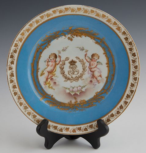 """French Sevres Style Cabinet Plate, 19th c., with gilt and putti decoration, around an """"LP"""" monogram, with a gilt leaf border around a heavenly blue ba"""