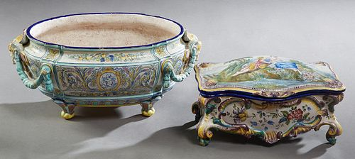 Two Pieces of French Style Polychromed Faience, consisting of an oval table jardiniere, 19th c., with garland draped applied masque handles, the flora