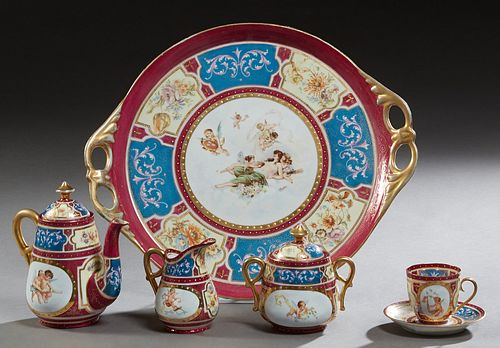Royal Bonn Seven Piece Porcelain Tea Set, c. 1900, consisting of a tray, teapot, covered sugar, creamer, two cups, and a saucer, all with floral and c